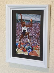 Carl Lewis - 8-time world champion and 9-time Olympic champion sprint and long jump - autographed framed photo + COA