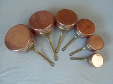 Set of 6 heavy copper saucepans with tinned inside.