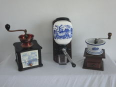 Three coffee grinders, among others with a scene with amill and boats - pottery