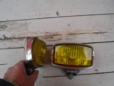Two used FOG LIGHTS with yellow glass from the 1960s and 1970s with a metal casing and glass width 140 mm.