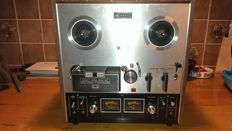 Vintage Akai tape recorder GX 210D, including empty metal reel