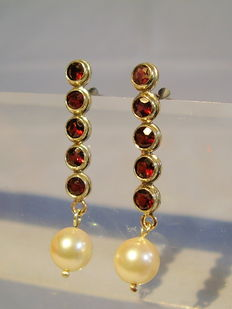 Gold earrings with faceted garnets and genuine white Akoya pearls