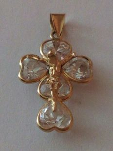 Cross in 18 kt yellow gold with cubic zirconia