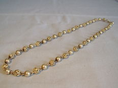 Antique necklace with filigree and polished beads