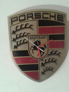 PORSCHE logo as the clock on the wall.Stainless steel INOX - 2014