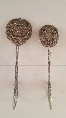 Two Silver cream puff tongs, Germany, 20th century.