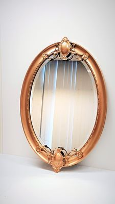 Large oval mirror in wooden frame