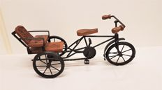 Metal rickshaw-style tricycle