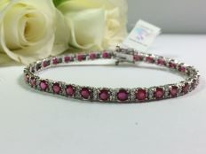 Exclusive ladies' 18kt white gold bracelet with diamonds and rubies with IGI certificate