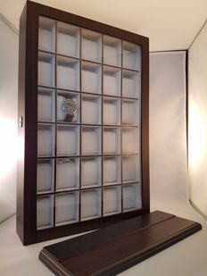 Very luxurious and elegant, durable solid-ebony watch display case for thirty watches; with lock