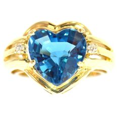 Yellow gold ring with blue topaz and diamonds of 5.54 ct in total - no reserve price-