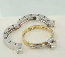 18 kt bi-colour gold three-stone ring, set with brilliant-cut diamonds by the brand Storks with an engraving