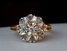 18kt gold ring with diamonds.