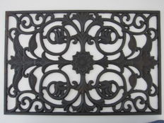 Old cast iron cutting window for fanlight.