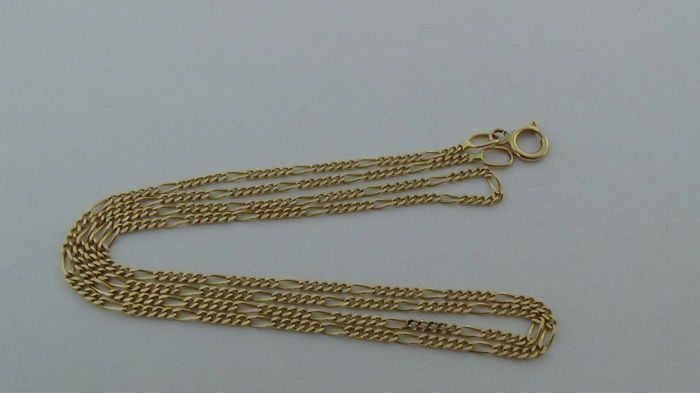 Gold Figaro link necklace of 14 kt – length: 43.5 cm.