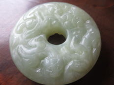 Chinese light green Jade hand carved Pi disc, 20 th Century