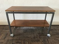 Manufacturer unknown - vintage,  teak wooden side table with steel frame.