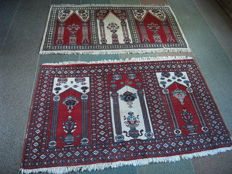 Two handmade Pakistani rugs in good condition, 155 x 85 and 155 x 95 cm