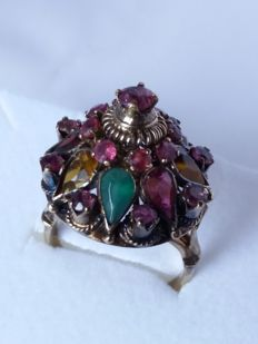 Ring with brilliant cut rubies, droplet cut garnet, droplet cut emerald, droplet cut sapphires.