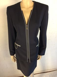 Escada - skirt suit consisting of a tailored fit jacket and a straight skirt.