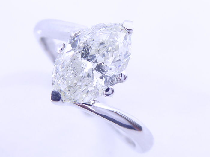 Ring with a 1.50 ct marquise cut diamond.
