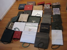 Set of 29 bags from many luxury brands: Patek Philippe, Rolex, Omega, cartier etc.