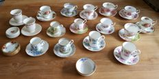Lot of English cups and saucers from various brands including Royal Albert