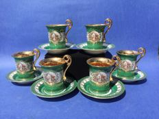 6-Piece set of porcelain gold-plated coffee cups and saucers.