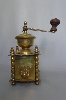 Yellow brass coffee grinder
