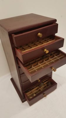 Wooden haberdashery cabinet with approx. 300 watch glasses