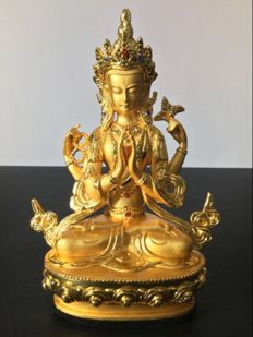 Representation of Boddhisattva Chenrezig in an alloy with gold patina - Tibet - Early 21st century.