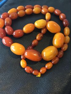 Antique necklace of 100% natural  orange egg yolk Amber, 94.2 grams, from mid and late 19th century