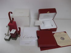 Cartier set consisting of: Wristwatch storage box (Cartier model reference COWA0043), instruction booklet, guarantee,  and 3 different watch display stands.