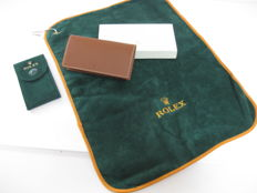 Rolex set consisting of: green golf club cleaning cloth with logo, leather address book, green watch case – All new.