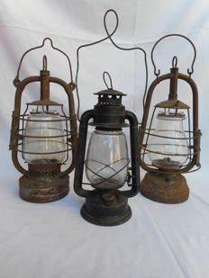 Three decorative old storm lamps  __ lanterns
