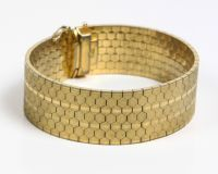 Very heavy, wide bracelet ca. 20,7mm gold plated with 750/18 karaat gold about 1960/70s Germany. Good clasp with extra safety.