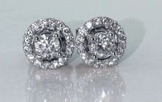 Day & Night earrings set with brilliant cut diamonds, 0.74 ct in total