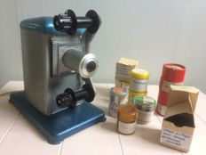 Roll film projector with manual control and 10 films