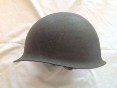 Steel helmet from the US army. Period: 1940s/1950s, with attachment strap but without the inner part.