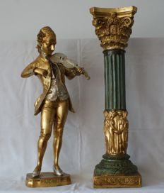 Baroque sculpture of Wolfgang Amadeus Mozart standing on a column.