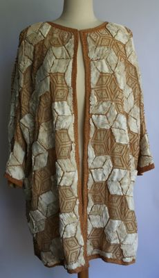 Fashion store Shabanou Utrecht - Vintage handmade tunic lined with beads and strips of fabric.