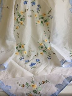 Hand embroidered batiste tablecloth.
