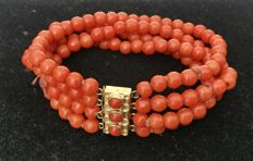 Four-strand red coral bracelet with gold clasp