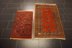 Two hand-knotted Persian carpets – Pakistan – Bukhara – Set 63 x 105 cm, 93 x 145 cm – made in Pakistan