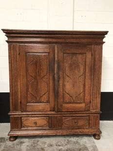 Robust oak linen cabinet with two doors and two drawers - Germany - circa 1850