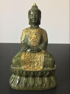Representation of Buddha in bronze with green patina and gold - Nepal - End of 20th century.