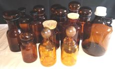 Lot of vintage apothecary bottles in different sizes