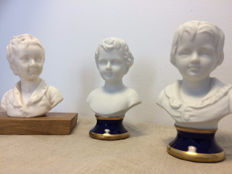 3 children's busts in French biscuit and resin with bases in porcelain