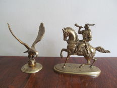 Brass statue of a hunter on horseback and an eagle