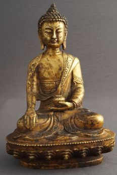 Sculptured of seated Buddha on lotus throne - China - 21st century